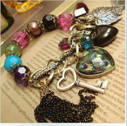 Wholesale New fashion girls restore ancient ways large heart tassels gemstone hand chain women lady bracelet bangle
