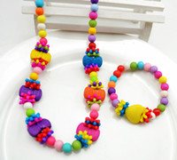 Wholesale Color ball snow bowknot Girl necklace bracelet baby color beads flowers necklace bracelet