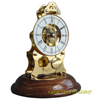 Wholesale Mechanical skeleton movement brass table clock Key wind solid wood base