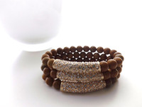 Wholesale New Fashion Charm Brown Wooden Bead Honesty Sideways Plating Rose Gold Bar Stretch Bracelet Jewelry