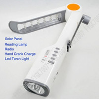 Wholesale EMS Multi function Solar Crank Dynamo Reading Desk LED Light FM Radio Flashlight Phone Charger