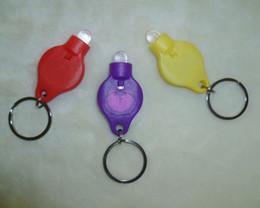 Wholesale Plastic LED key chain belt light key chain lights glowing MCD key gift plastic LED key chain kids gift toy for christmas