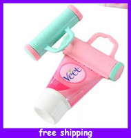 Wholesale Plastic Rolling Toothpaste Tube Squeezer Dispenser with sucker Toothpaste Saver