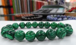 The vogue spread of the malachite round bead bracelet - shambhala bracelet