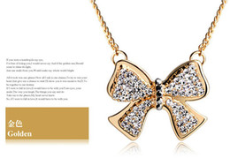 Christmas Promotion bow crystal pendant long necklace, Golden silver,free shipping