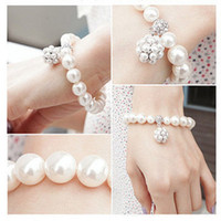 Wholesale fashion beautiful color pearl alloy bowknot elastic charms Bracelet