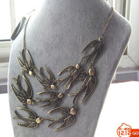Wholesale European and American retro metal alloy the Golden Swallow fashion long necklace