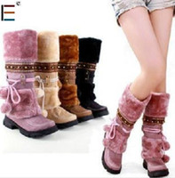 Wholesale Winter fashion snow boots low heeled fur ball decoration ladies boots over the knee snow shoes for w