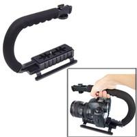 al por mayor apretones de cámaras dslr-Forma C Flash Soporte de Pie Agarre soporte para Videocámaras DV DC Cámara RÉFLEX digital con Forma de C con Soporte