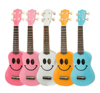 Wholesale Lovely Ukulele Soprano Ukulele with Smile Face Five Colors Available Free Bag