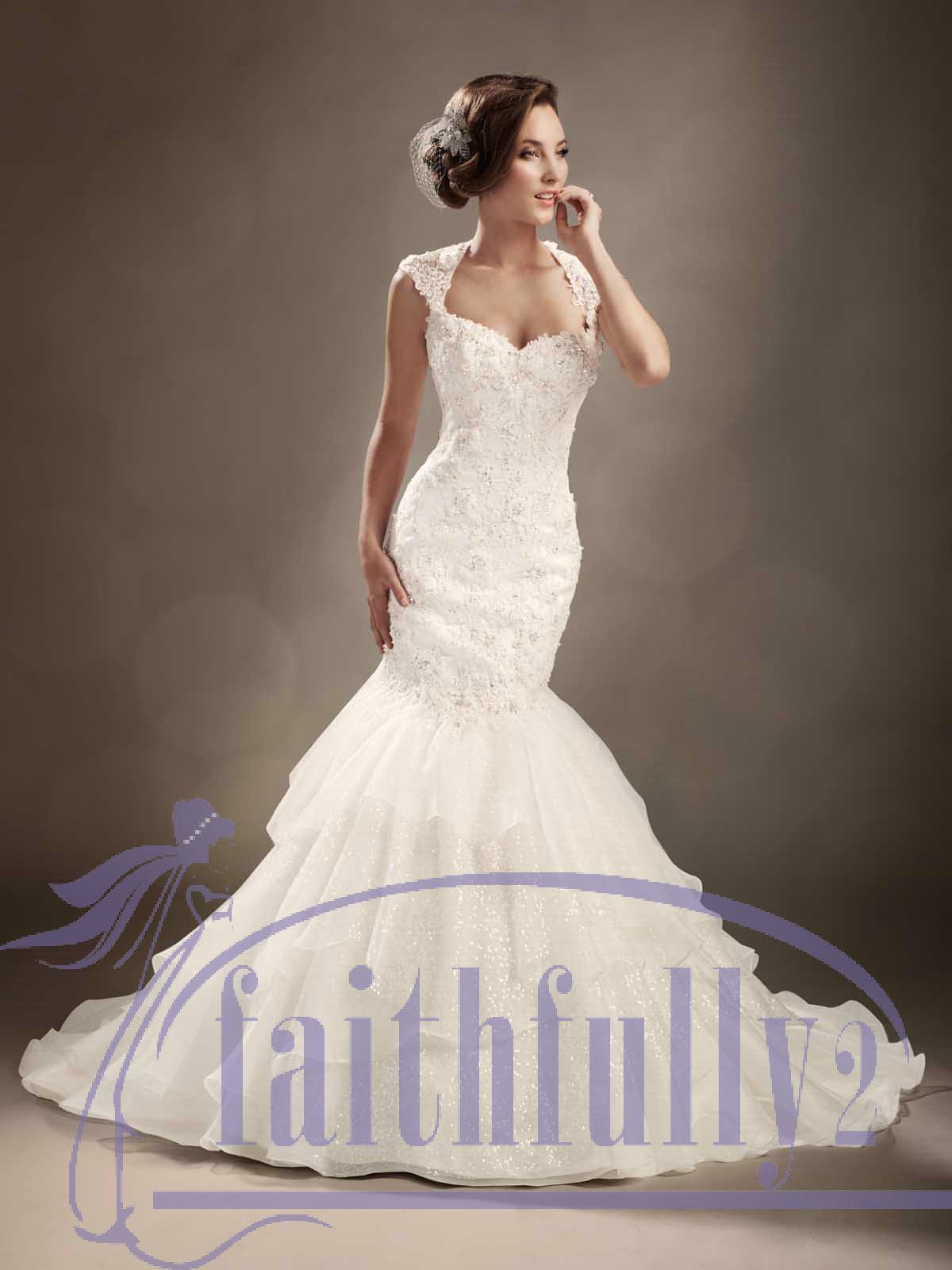 Pictures of winter mermaid wedding dresses cap sleeves for Winter mermaid wedding dresses