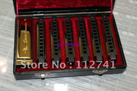 Wholesale Newest hole tone senior blues golden tune set packing square harmonica large spec