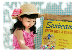Wholesale Hat flowers beach hat bow of children wavy brim straw hat bucket hats girls