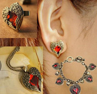 Wholesale mix order Min order is Vintage amp Retro Ruby Peach Heart Wings Jewelry Sets Necklace Rings Earri