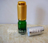 Cheap 5ml green essential oil bottle with silver gold pressure electronic aluminum cap ,glass dropper
