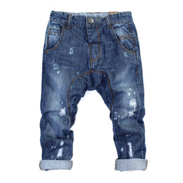 Wholesale 2013 new children boys and girls hole paint jeans denim trousers
