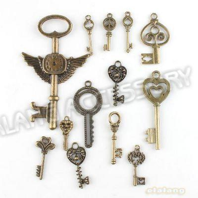 148pcs / lot En vente Nouveau Assorted Charms clés en alliage chromé Vintage Bro