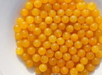 Wholesale Handmade beads beige jade a diameter of about mm to a pack