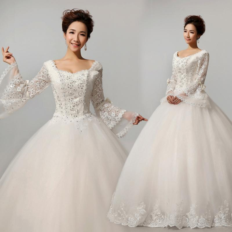 Beautiful long sleeves puffy tulle hand beaded bride for Beautiful puffy wedding dresses