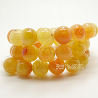 Wholesale 10mm through drilled cracked yellow round agate bead AAA semi precious gemstone jewelry loose beads