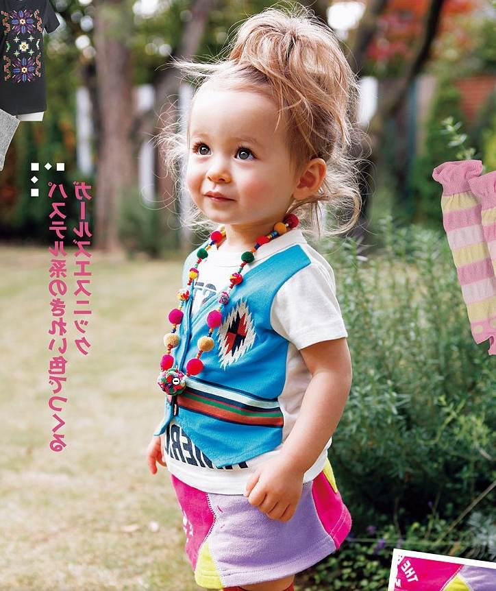 2 year girl hairstyle : Pin cute year old girl is standing outside stock photo