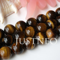 Wholesale 10mm through drilled tiger eye beads AAA semi precious gemstone jewelry loose stringing beads