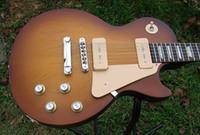 Cheap best Factory Mahogany guitar 60's Tribute Honeyburst Rare Darkback electric guitar OEM Available Che