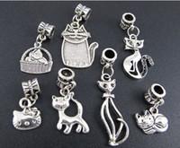 Revisiones Gatos de perlas-Los granos grandes tibetanos del encanto de la aleación del agujero del gato de la mezcla de plata tibetana 140pcs / lot cupieron la joyería europea DIY 140pcs / lot de la pulsera