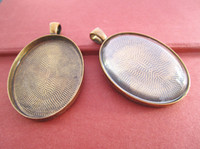 Wholesale 30mmx40mm Antique Bronze and antique gold Oval Pendant Trays with Glass Cabochons set