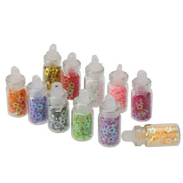 Wholesale 12 Colors Bottled Nail Art Decoration Hollow Five pointed Star set