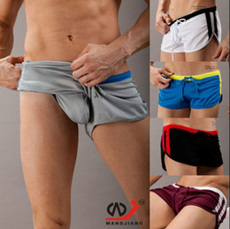 Wholesale Hot Sexy Men s Casual Shorts Household Sports Shorts with G string Jocks Straps Inside Pouch Gym Trunks Mesh Quick Dry Boxers M L XL