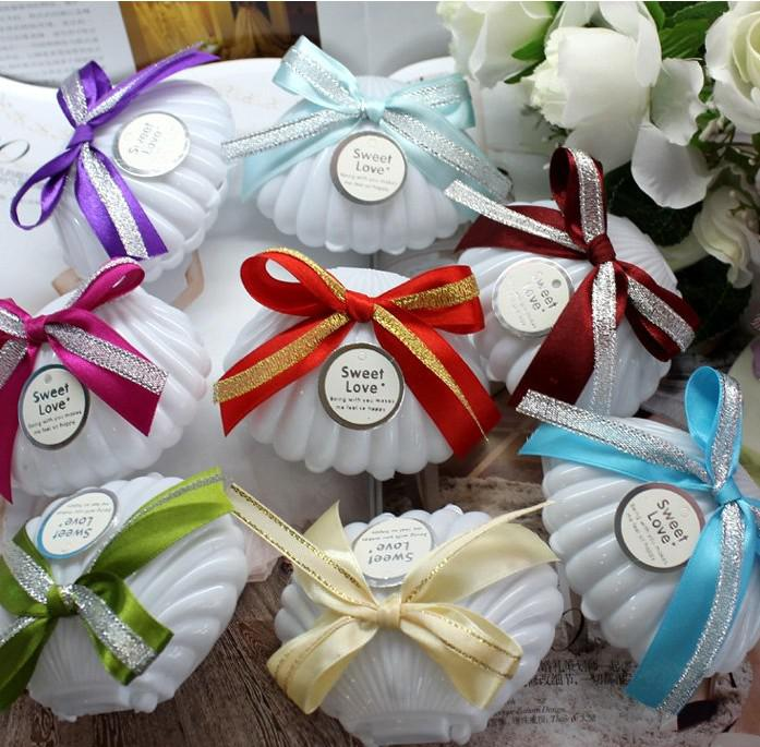 http://www.dhresource.com/albu_327433224_00-1.0x0/2013-new-candy-colors-shell-candy-boxes-wedding.jpg