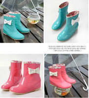 Wholesale Increased rain boots women s water shoes within the bow patent leather Tall rubber boots