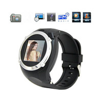al por mayor cámara del reloj del mp3 mp4-1.5 pulgadas muñeca reloj teléfono celular MQ998 GSM banda cuádruple con Bluetooth MP3 MP4 FM 1.3MP cámara