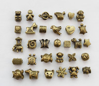 30PCS Assorted antiqued bronze euro beads for charm bracelet...