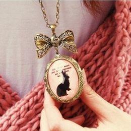Joyería de moda al por mayor de envío libre Bow Fase del suéter del collar del conejito Caja retra de la cadena # 8025