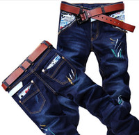 Wholesale 2013 Spring Jeans Men s Jeans Pocket Cartoon Hit Color Jeans Painted Slim Jeans