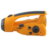 Wholesale Handle Emergency Dynamo Electricity Flashlight with LED Light FM Radio Charger solar torch