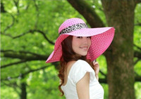 Wholesale Summer new Ms sandy beach hat the bow ribbon straw hat hollow brimmed hat child