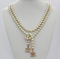 Wholesale nice long glass pearl sweater stamped camellia love necklace