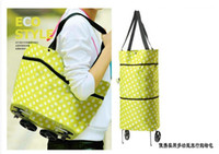 Wholesale 100pcs fabric Portable folding tug package shopping bag travel bag car trolley car cart