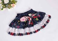 Nuevo estilo coreano ropa bebé niñas tutú faldas moda infantil punto faldas jean bowknot dulce niños estrellas capas de ropa t5076