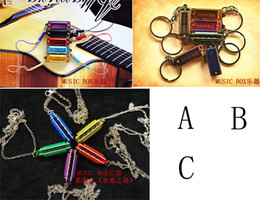 Wholesale MUSIC BOX Harmonica Four hole Tone Mini Harmonicas World s Smallest Harmonica Musical Instruments With Necklace Key Ring