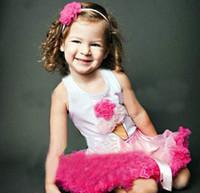 Compra Trajes de algodón cordones diseños-El juego rosado para la camiseta sin mangas de la niña y la falda del diseño del cordón Cottoned la alta calidad 2013 venta caliente E11