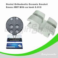 Yes Yes  Free shipping Dental Orthodontic MBT Ceramic Bracket Brace with No Hook 0.018