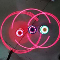 Wholesale Cool kids laser spinning top toys imitation wood led light up music rare beyblades
