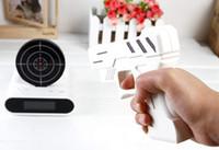 Wholesale Novelty Uniqiue Gadgets Unique LCD Laser Gun Target Shooting Toy Alarm desk Clock