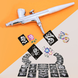 Wholesale Buy Airbrush Pen Gravity Tattoo Spray Gun Get Mixed Design Sheet Stencils free sample Kit Supply