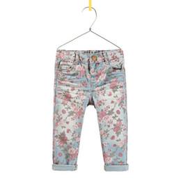 Wholesale Niños Jeans Ropa populares de la manera impresas pantalones vaqueros del dril de algodón para niños Niños pantalones ocasionales de los tejanos de los pantalones largos pantalones de las muchachas flor linda