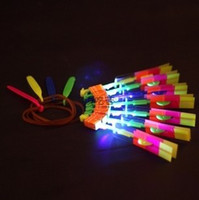 Wholesale 2013 Hot sale EMS Single Flying LED Light Up Slingshot Helicopter Toy Plastic Flyer with Free Parts